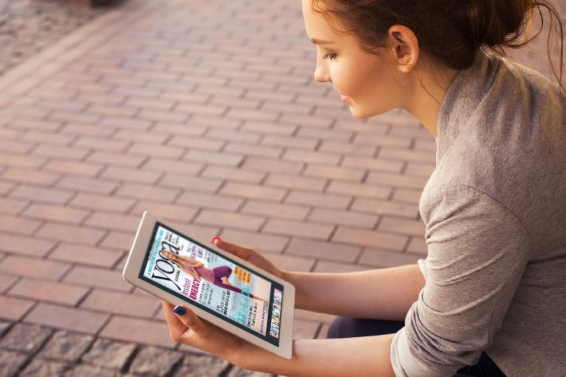 Woman with PDF to HTML5 flipbook tablet